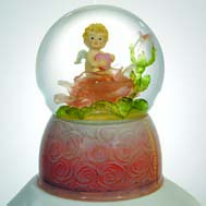 Cherub holding heart on rose base
